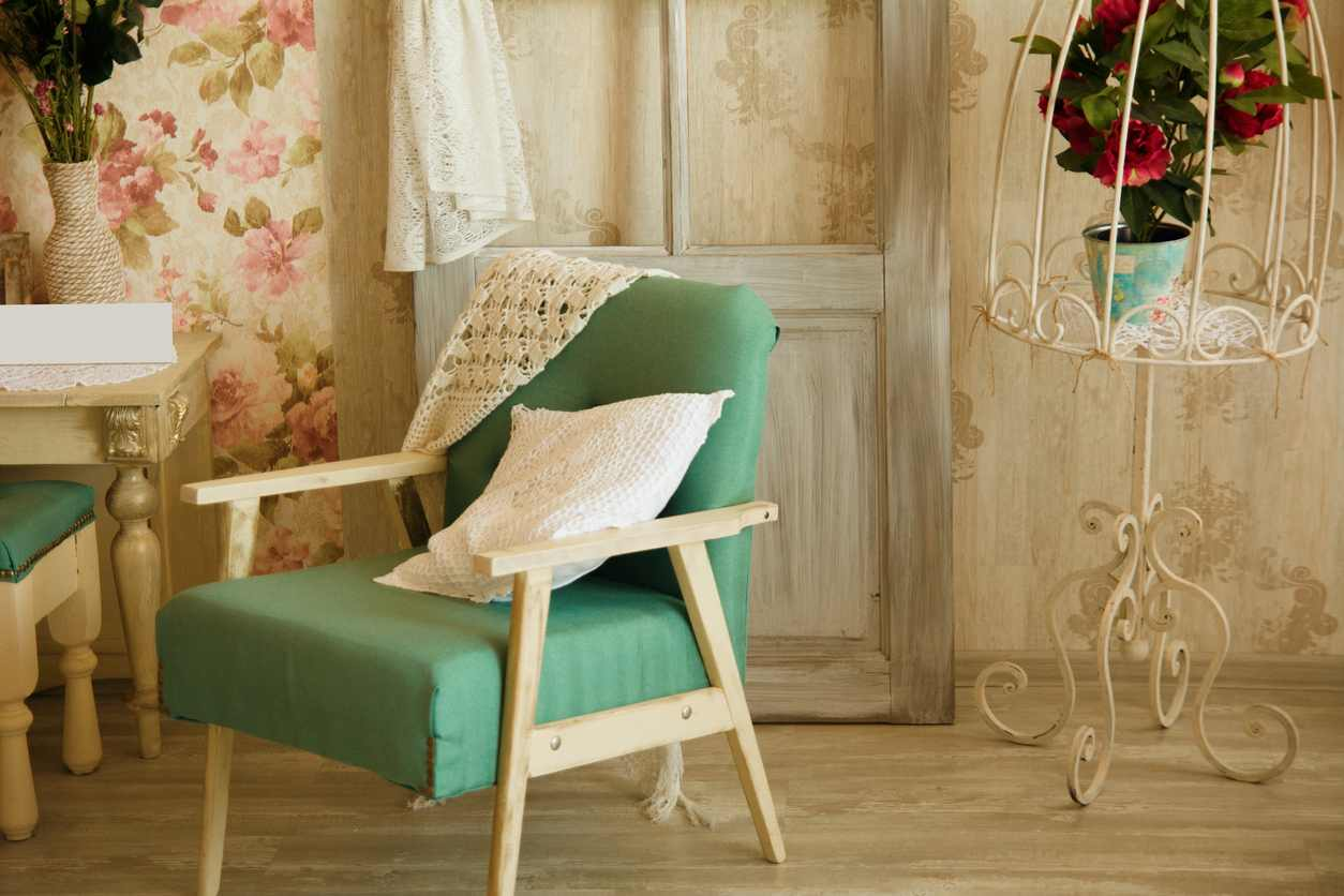 Interior room with chairs, pillows, door and flowers. Room in retro style.