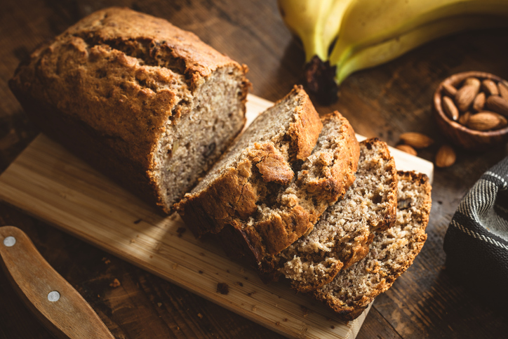 Banana Bread Loaf On Wooden Table